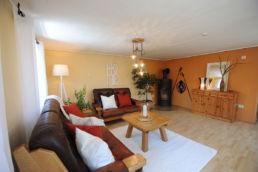 Wohnzimmer Home Staging Orange aufbereitet